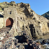 Boat houses in the cliffs at Pollara on Salina island, Italy