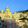 Moon rising over Marina Corricella on the island of Procida, Italy