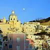 Moon rising over Marina Corricella on the island of Procida, Italy