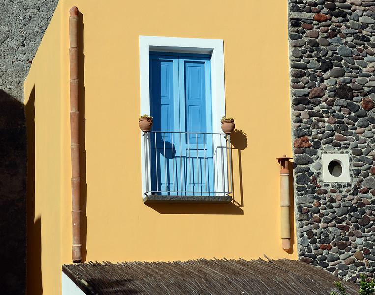 Detail of restored villa along the waterfront of Santa Marina on Salina island, Italy