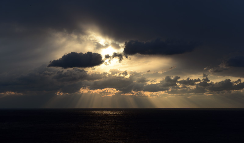 Jacob's ladder and turbulent skies over the sea near Capri, Italy