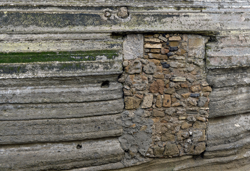 Closed off entrance in volcanic ash layers, Castello d'Avalos on Procida island, Italy