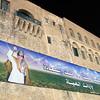 Giant billboard on Tripoli's old castle, celebrating Moammar al-Qadhafi's reign before the start of the civil war in Libya