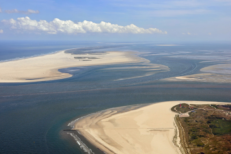Lighthouse at north end of the island of Texel, with Vlieland and Terschelling in the background, The Netherlands