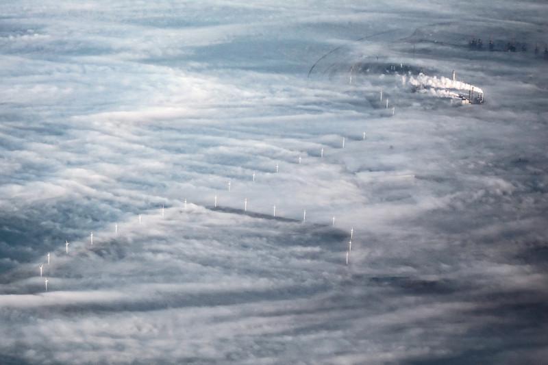 Coastal windmills in ground fog, The Netherlands