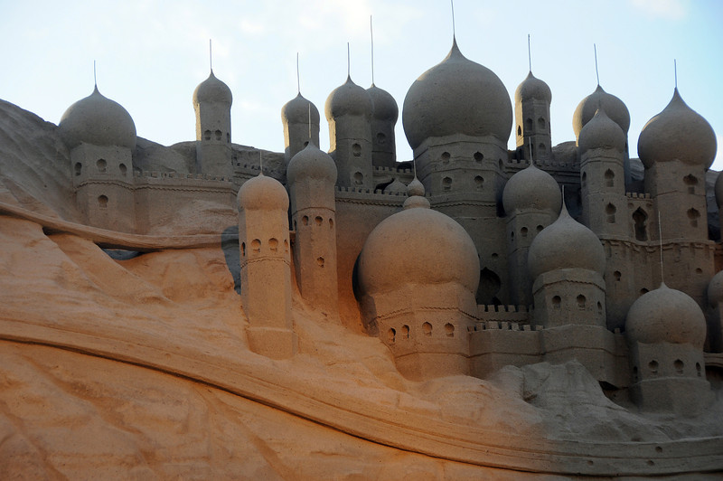 Giant oriental sandcastle in reflected light, The Netherlands