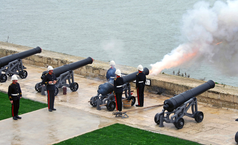 Mid-day ceremonial gun salute from defensive wall overlooking the Grand Harbour of Valetta, Malta