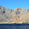 Deformed Triassic sedimentary rocks along the north shore of the Khor Ash Sham fjord in the Musandam peninsula, Oman