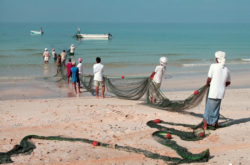 Omani fishermen along the west coast of the Musandam peninsula, Oman