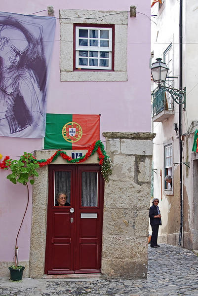 Street talk in the Alfama district, Lisbon, Portugal