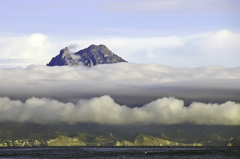 Puig Campana (1406 m) piercing morning fog along the Costa Blanca, southeast Spain