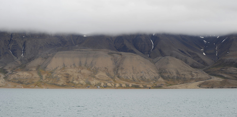 Dwellings along the northern shore of the Adventfjorden, Svalbard