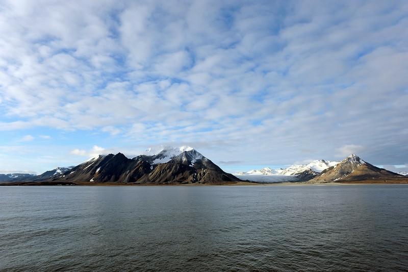 Early morning vista across the Bellsund to the Martinfjella ridge (at right), the wide Antonia glacier and the Berzeliustinden massif (1210 m), Svalbard
