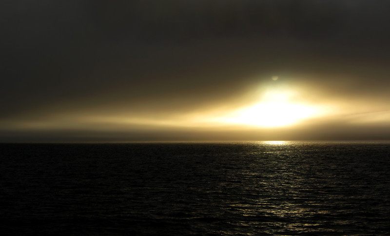 Foggy midsummer night over the Greenland Sea, western Svalbard