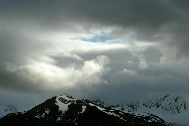 Cloud window over Tilasberget (686 m) along the inner Van Keulenfjorden, Svalbard