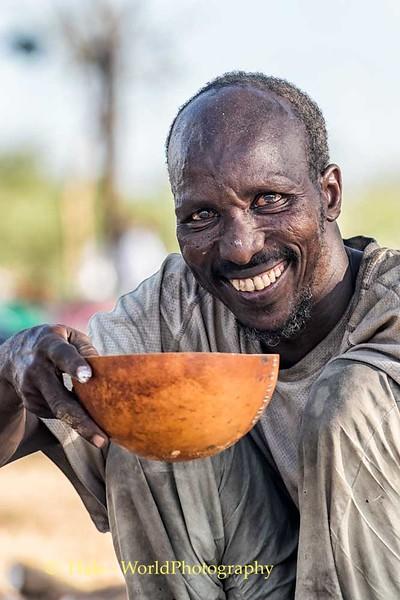 Enjoying his gourd of coffee