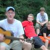 Mike Hedlund, Tom Dils, Alexander Muller, Falk Gerke<br /> Mike shows off his improv musical talent at camp