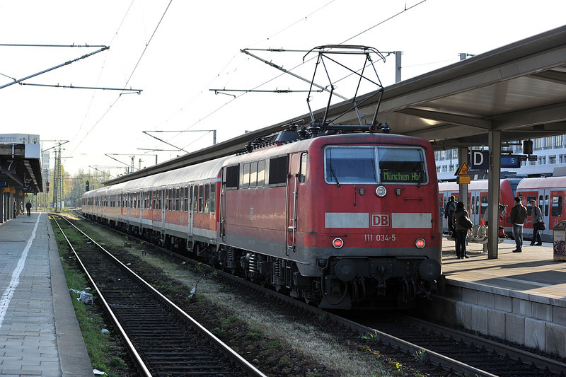 DB 111.034 waits to leave Munchen Ost with its train for the Hauptbahnhof on 15 April 2011