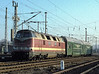 DR 228.784 has a rake of old style double deck coaches in tow at Arnstadt on 29 November 1992