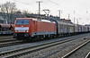 DB 189.037 heads north with a long train of mixed freight wagons