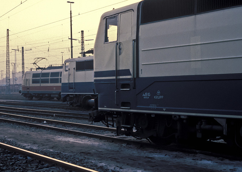 DB locos line up to wait their next duties at Bw Stuttgart on 29 January 1989. 181.223 is nearest the camera and sanwiches an unidentified Class 110 along with 103.141 furthest away