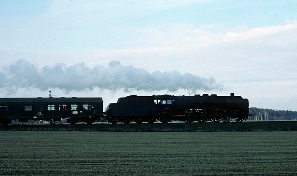 Deutsche Reichsbahn 01 2137, near Schonefeld, east Berlin, Fri 11 February 1977.  The 01 Pacific heads the 1215 from Dresden.  Photo by Les Tindall.