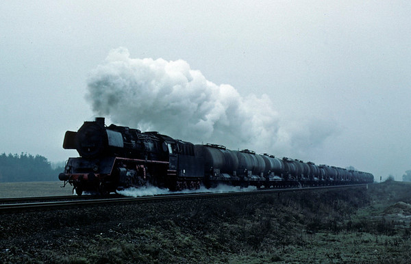 Deutsche Reichsbahn 50 0041, near Danewitz, Sun 13 February 1977.  The 2-10-0 heads a tank train towards east Berlin on the main line from Stralsund and Szczecin.  Photo by Les Tindall.