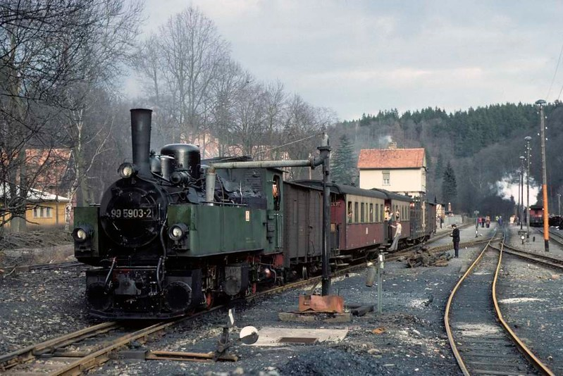 Deutsche Reichsbahn 99 5903, Alexisbad, Sat 12 February 1977. Taking water before working a mixed train to Strassberg.  Photo by Les Tindall.