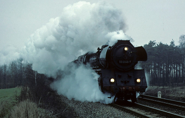 Deutsche Reichsbahn 03 0046, near Danewitz, Sun 13 February 1977.  The 03 light Pacific roars past with the 0748 Stralsund - east Berlin express.  Photo by Les Tindall.