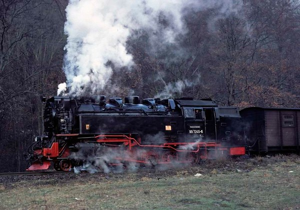 Deutsche Reichsbahn 99 7245, near Netzkater, Sat 12 February 1977 1.  Here are four shots of the metre-gauge 2-10-2T heading the morning passenger train from Wernigerode to Nordhausen.  Photo by Les Tindall.