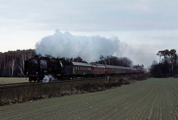 Deutsche Reichsbahn 01 2029, near Schonefeld, east Berlin, Fri 11 February 1977.  The 01 Pacific accelerates away from Schonefeld with the very heavy 1344 from Ostbahnhof.  Photo by Les Tindall.