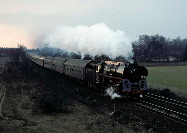 Deutsche Reichsbahn 01 1514, near Schonefeld, east Berlin, Fri 11 February 1977.  The rebuilt 01 Pacific heads the 1334 from Dresden to Berlin Ostbahnhof.  Photo by Les Tindall.