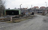 Zittau NG yard and shed, Tues 8 February 2011 1.  Looking west.  Beyond the shed and out of sight in this photo is a standard gauge semi-roundhouse which houses the railbuses used on the Mandau Rly.  It runs clockwise from Zittau thorugh the Czech Republic to re-enter Germany and join the Zittau - Dresden line at Eibau.  The DB line into Zittau main station is at right.  (The station is behind the camera).