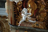 A <i>putto</i> carries a candle in the rococo church at Kloster Andechs.