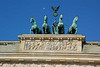 Horses atop Brandenburg Gate and new moon