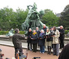 Choir singing in front of monstrous statue in Altona, once an independent city, now a district in Hamburg
