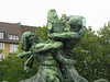 Statue is two centaurs wrestling over a big fish, said to represent historical rivalry between Altona and Hamburg over the fishing industry