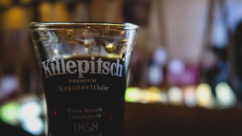 Drinking Killepitsch, a popular liqueur in Düsseldorf.