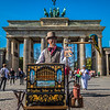 Organ Grinder and his parrot outside of Brandenburg Gate, Berlin