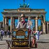 Organ Grinder and his parrot outside of Brandenburg Gate, Berlin