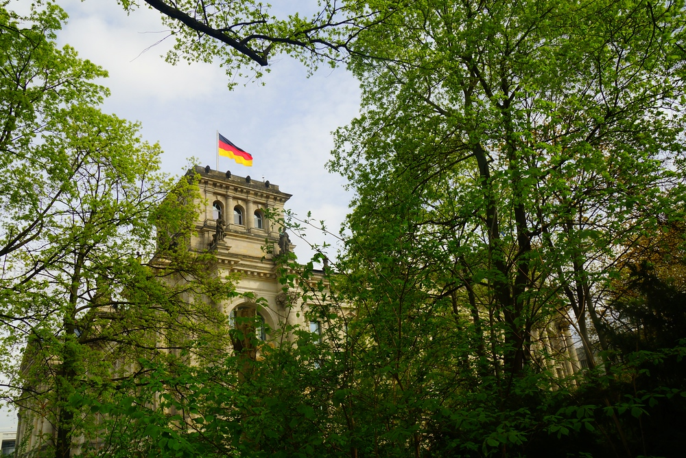 A view of Reichstag as camouflaged by the trees in Berlin