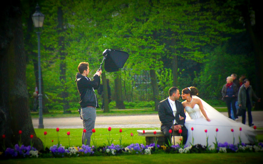 A couple taking wedding photos at Charlottenburg Palace and Gardens