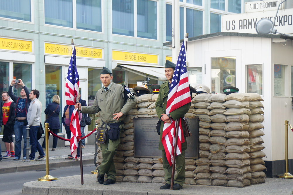 Soldiers standing outside of Checkpoint Charlie in Berlin, Germany
