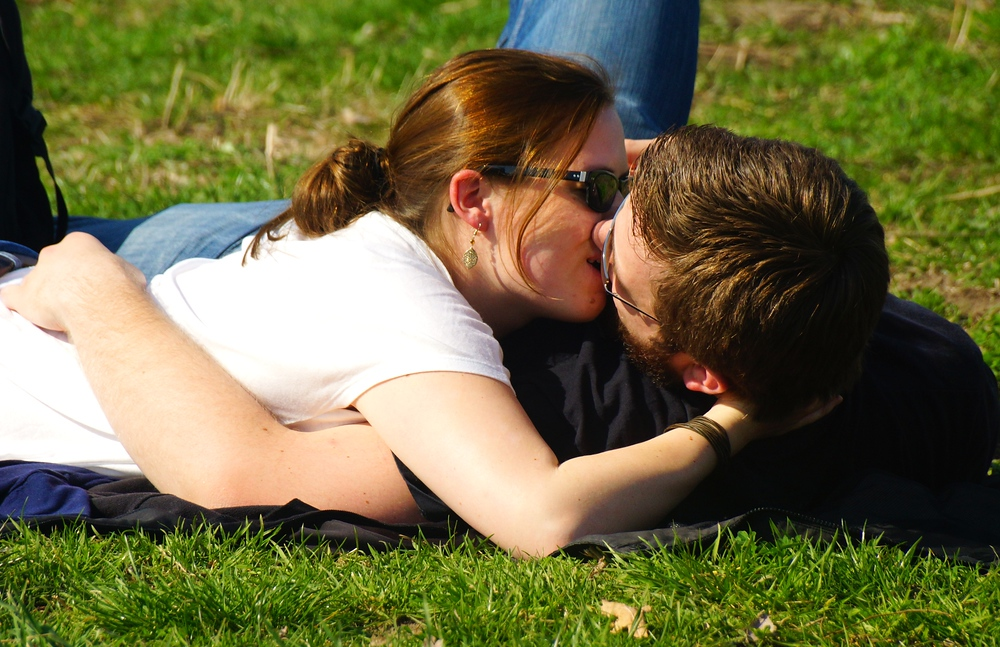 The most intimate photo of the day - a couple kissing on the grass of Mauerpark in Berlin, Germany.