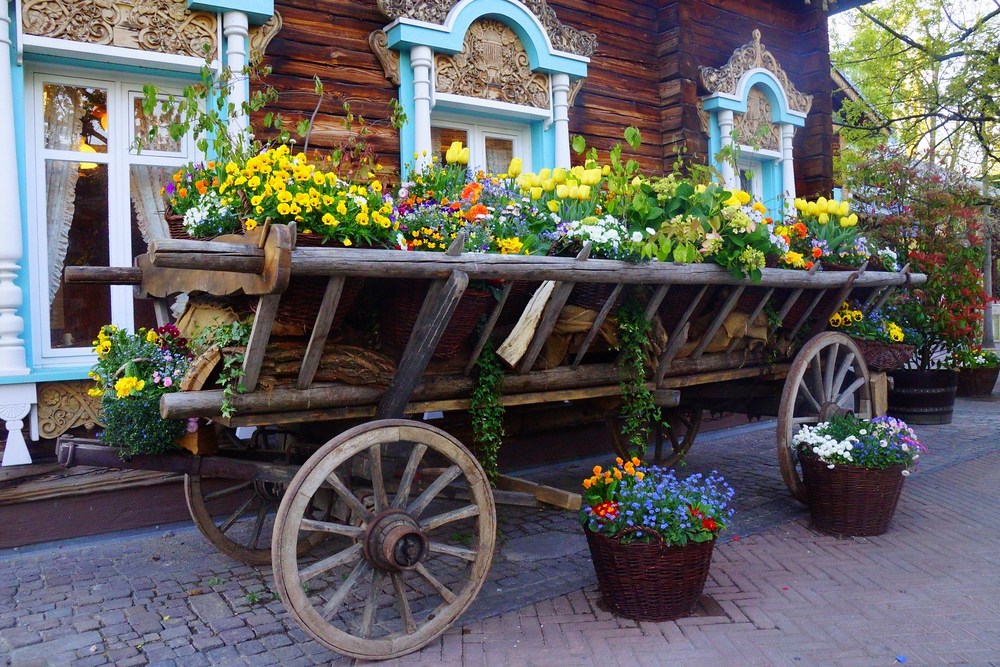 A wagon filled with a colorful display of potted flowers.