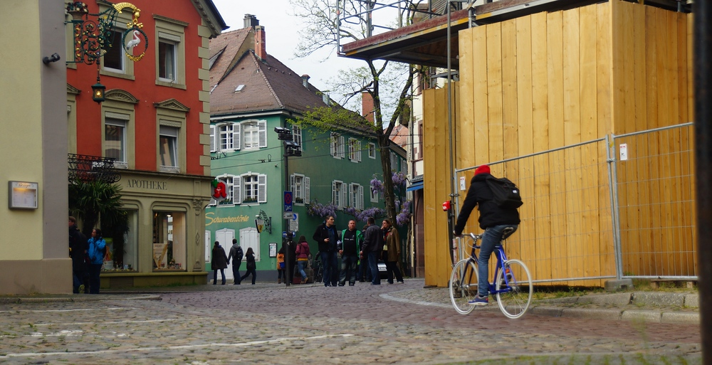 A typical scene from the Old Quarter - pedestrians and bicycles dominating versus traffic from vehicles.