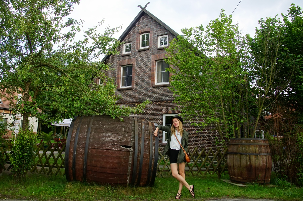 Audrey Bergner That Backpacker posing by a large barrel in Spreewald, Germany