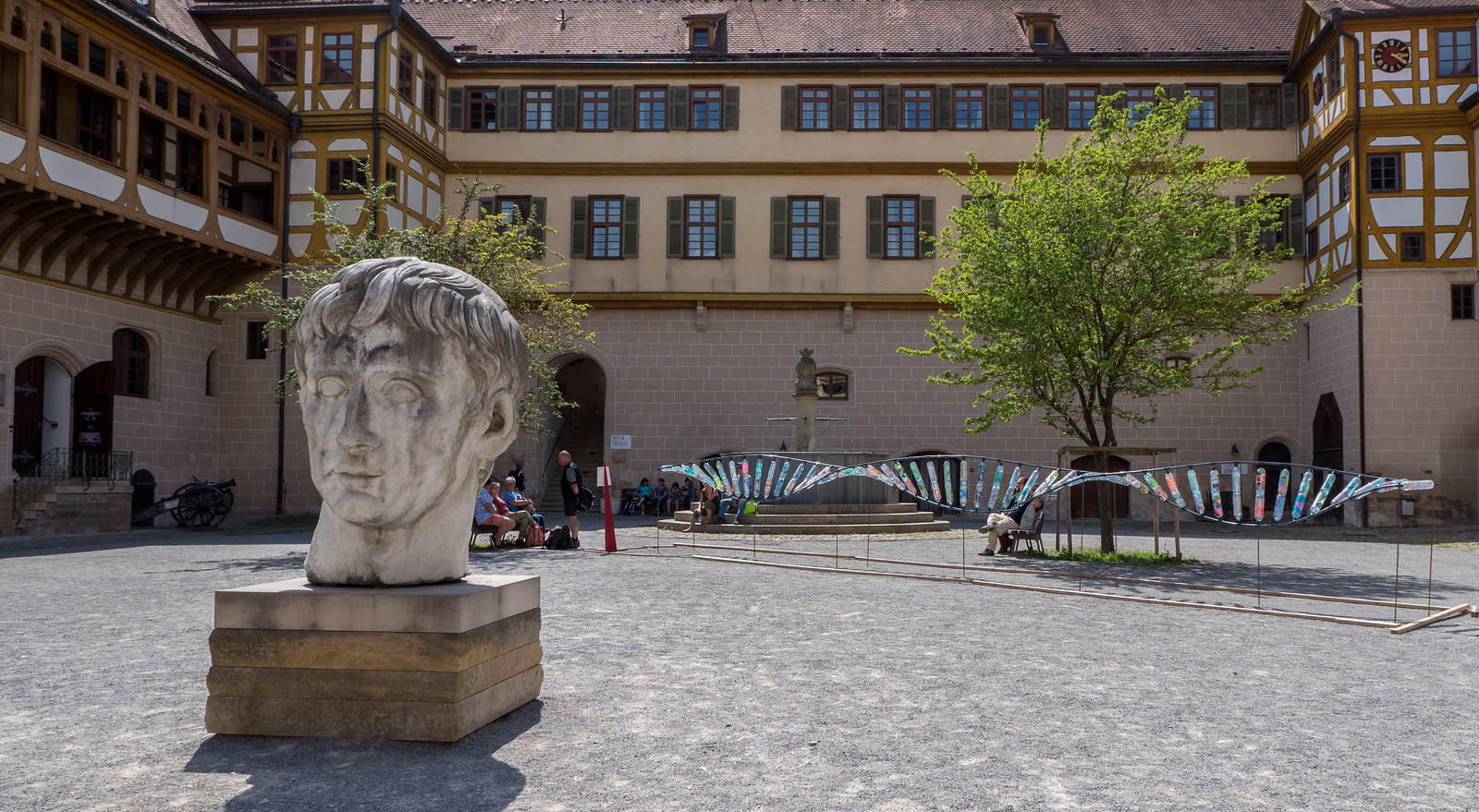 Things to do in Tubingen Germany. DNA sculpture in courtyard of castle in Tubingen.