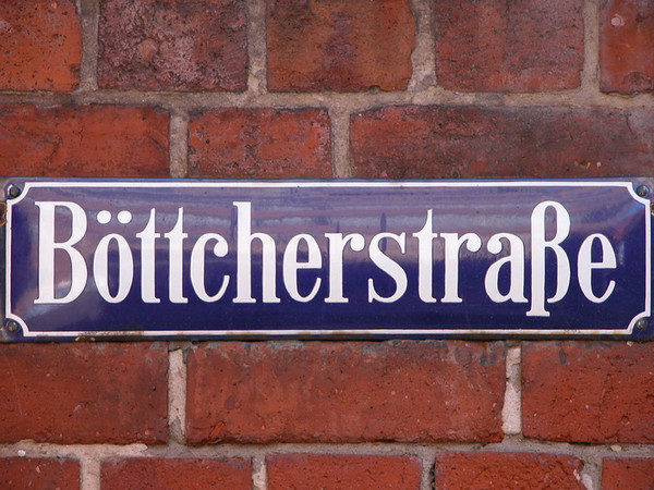Böttcherstraße is a street in the historic centre of Bremen, Germany. Only about 100 m (330 ft) long, it is famous for its unusual architecture and ranks among the city's main cultural landmarks and visitor attractions. Most of its buildings were erected between 1922 and 1931, primarily as a result of the initiative of Ludwig Roselius, a Bremen-based coffee-trader, who charged Bernhard Hoetger with the artistic supervision over the project. The street and its buildings are a rare example of an architectural ensemble belonging to a variant of the expressionist style. Several of the houses can be classed as Brick Expressionism.