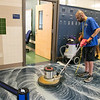 Dan Evans a custodian at Leominster High School works on getting the floors ready for the first day of school. SENTINEL & ENTERPRISE/JOHN LOVE